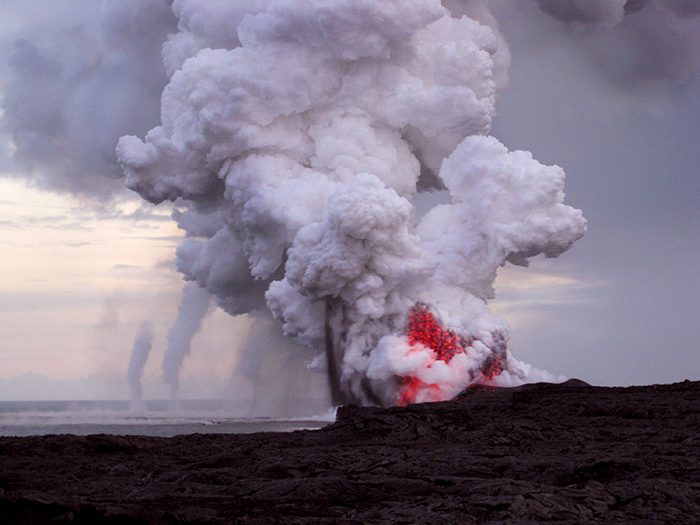 Violent explosion as hot lava flows into the sea from Kilauea volcano, Hawaii.