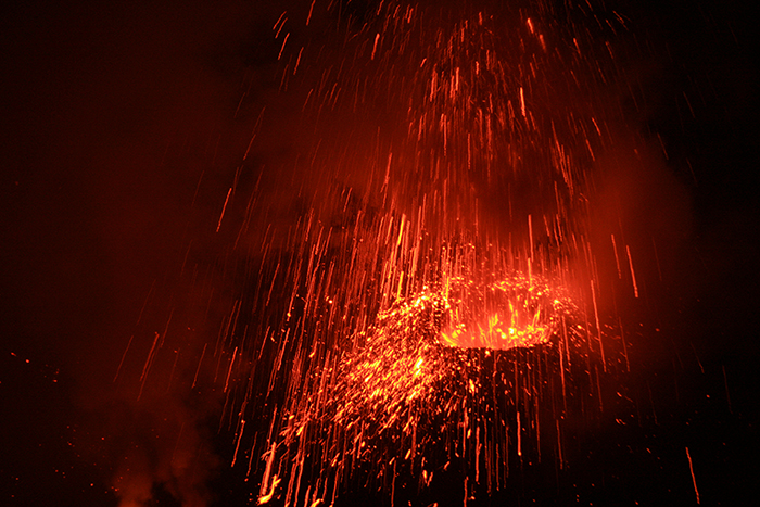A vent at the top of Stromboli, Italy, erupts at night, spewing out molten lava.